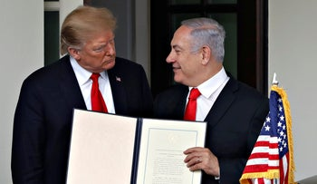 U.S. President Donald Trump and Israel's Prime Minister Benjamin Netanyahu hold up the Golan Heights proclamation outside the West Wing after a meeting in the the White House March 25, 2019.