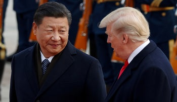 FILE Photo: U.S. President Donald Trump and China's President Xi Jinping meet business leaders at the Great Hall of the People in Beijing, China, November 9, 2017.