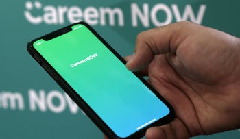 File photo: Careem CEO Mudassir Sheikha shows the logo of the company's delivery service Careen NOW on his mobile at the company headquarters in Dubai, UAE, December 13, 2018.