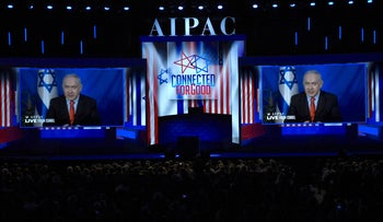 Prime Minister of Israel Benjamin Netanyahu speaks on screen from Israel, during the AIPAC annual meeting in Washington, March 26, 2019.