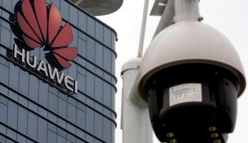 File photo: A surveillance camera is seen in front of the Huawei logo outside its factory campus in the Guangdong province in China, March 25, 2019.