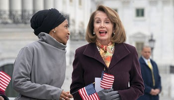 "Rep. Ilhan Omar, D-Minn., left, joins Speaker of the House Nancy Pelosi, D-Calif., as Democrats rally outside the Capitol ahead of passage of H.R. 1, ""The For the People Act,"" a bill which aims to expand voting rights and strengthen ethics rules, in Washington, Friday, March 8, 2019"