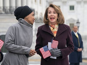 """Rep. Ilhan Omar, D-Minn., left, joins Speaker of the House Nancy Pelosi, D-Calif., as Democrats rally outside the Capitol ahead of passage of H.R. 1, """"The For the People Act,"""" a bill which aims to expand voting rights and strengthen ethics rules, in Washington, Friday, March 8, 2019"""