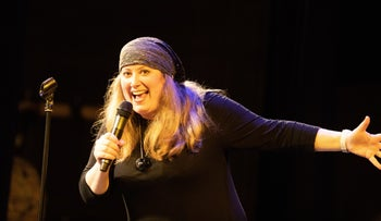 Rachel Creeger performing her stand-up show in Britain.