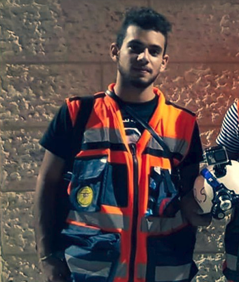 17-year-old Sajed Munjed wearing the reflective vest