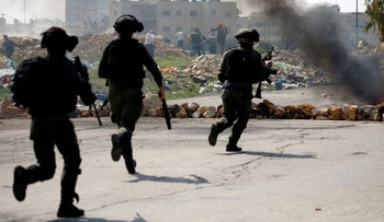 Israeli soldiers clash with Palestinians near Ramallah in the West Bank, March 2019