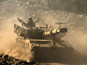File photo: An Israeli mobile artillery drives through sandy terrain during a military exercise in the Golan Heights, September 19, 2012.