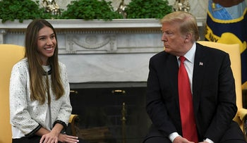 President Donald Trump, right, listens during a meeting with Fabiana Rosales, left, a Venezuelan activist who is the wife of Venezuelan opposition leader Juan Guaido, as she speaks in the Oval Office of the White House in Washington, Wednesday, March 27, 2019