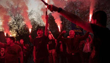 File photo: Members of the nationalist group Sokil, the youth wing of the Svoboda party, chant slogans and light flares during a concert in Kiev, Ukraine, April 21, 2018.