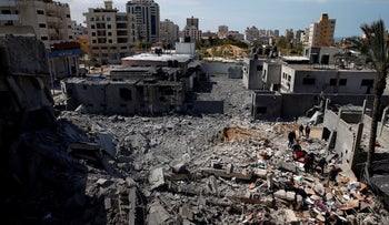 Palestinians inspect a destroyed Hamas site after it was hit by an Israeli air strike, Gaza City March 26, 2019.