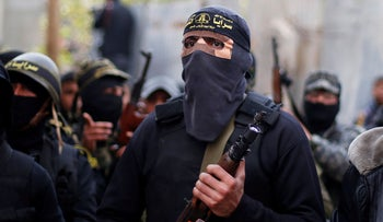 Islamic Jihad militants attend the funeral of Palestinian Jehad Hararah who was killed at the Israeli-Gaza border fence, in Gaza City. March 23, 2019