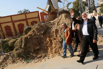 Hamas chief Ismail Haniyeh visits his office that was targeted in an Israeli air strike, in Gaza City March 27, 2019