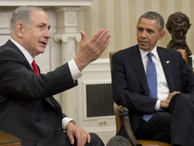 FILE Photo: U.S. President Barack Obama listens to Prime Minister Benjamin Netanyahu during a meeting in the Oval Office of the White House in Washington, D.C., March 3, 2014.