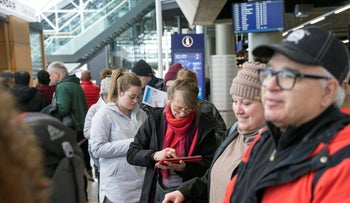 Stranded passengers set to travel with Icelandic airline Wow, wait in line at Iceland's international airport in Keflavik, March 28, 2019.