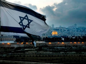 An Israeli flag flutters at Mount of Olives with the Old City of Jerusalem and its Dome of the Rock mosque in the center, March 27, 2019