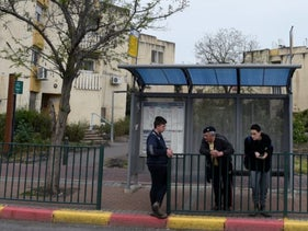 People waiting at a bus stop in Katzrin in the Golan Heights, March 2019.
