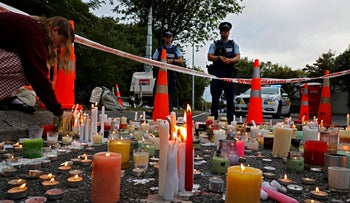 A student lights candle during a vigil to commemorate victims of March 15 shooting, outside the Al Noor mosque in Christchurch, New Zealand.