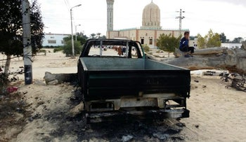 FILE PHOTO: A burned truck is seen outside Al-Rawda Mosque a day after Islamic State killed hundreds of worshippers, northern Sinai, Egypt, November 26, 2017.