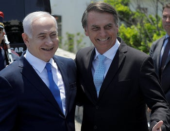 FILE PHOTO: Israel's Prime Minister Benjamin Netanyahu is welcomed by Brazil's President Jair Bolsonaro at the Copacabana fort in Rio de Janeiro, Brazil, December 28, 2018.