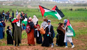 """Palestinian women protesters during a demonstration marking the first anniversary of the """"March of Return"""" protests, near the border with Israel east of Gaza City, March 30, 2019."""