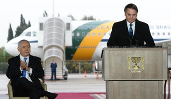 Netanyahu and Brazilian President Jair Bolsonaro during the latter's welcoming ceremony at Ben-Gurion International Airport, March 31, 2019