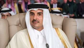 Qatar's Emir Sheikh Tamim bin Hamad Al-Thani attends the opening session of the 30th Arab League summit in the Tunisian capital Tunis on March 31, 2019.