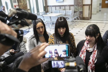 Australian women, Nicole Meyers, Dassi Erlich and Ellie Sapper speak to members of the media following a court hearing in the case of Malka Leifer at the District Court in Jerusalem March 6, 2019.