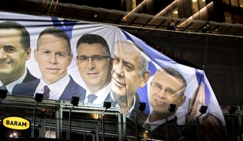 A banner featuring Prime Minister Benjamin Netanyahu is hung up in Ramat Gan, Israel, April 1, 2019.