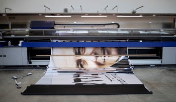 A banner featuring Prime Minister Benjamin Netanyahu rolls out of a printer in Tel Aviv, Israel, March 27, 2019.