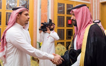 Saudi Crown Prince Mohammed, right, shaking Salah Khashoggi's hand, October 2018.