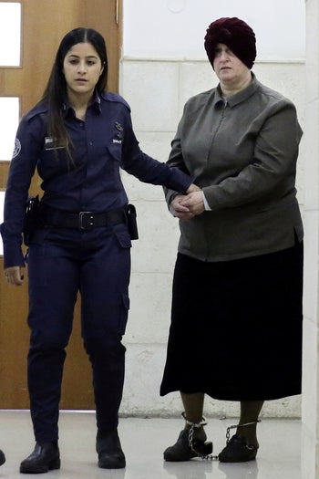 FILE:  Malka Leifer is brought to a courtroom in Jerusalem, Tuesday, Feb. 27, 2018.