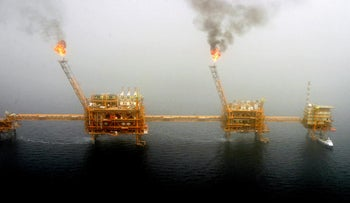 FILE PHOTO: Gas flares from an oil production platform at the Soroush oil fields in the Persian Gulf, south of the capital Tehran, July 25, 2005.
