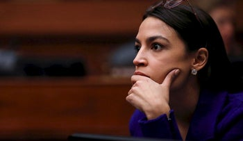 U.S. Rep. Alexandria Ocasio-Cortez (D-NY) listens as the House Oversight and Reform Committee votes to subpoena the White House about security clearances as the committee meets on Capitol Hill in Washington, U.S., April 2, 2019