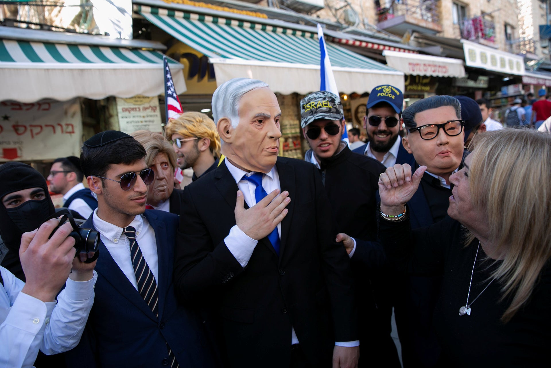 """Benjamin Netanyahu"" touring the Mahane Yehuda market in Jerusalem during a Purim celebration, March 19, 2019."