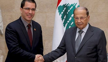 File photo: Venezuelan Foreign Minister Jorge Arreaza, left, shakes hands with Lebanese President Michel Aoun in Beirut, April 3, 2014.