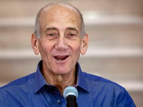 File Photo: Former Israeli prime minister Ehud Olmert speaks to the press at the District Court in Jerusalem after hearing the verdict in his trial, July 10, 2012.