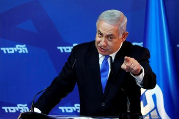 Israel's Prime Minister Benjamin Netanyahu gestures as he speaks during a news conference in Jerusalem April 1, 2019