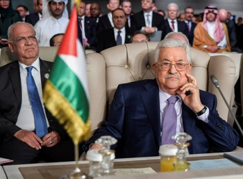 Palestinian President Mahmoud Abbas, right, and PLO secretary general Saeb Erekat, attend the the 30th Arab Summit in Tunis, Tunisia.  March 31, 2019