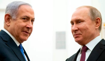 Russian President Vladimir Putin speaks with Prime Minister Benjamin Netanyahu during their meeting at the Kremlin in Moscow, Russia, April 4, 2019.