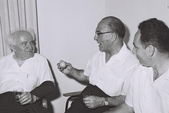 File photo: Prime Minister Levi Eshkol and Deputy Defense Minister Shimon Peres attend a meeting with David Ben-Gurion at the Israeli military headquarters in Tel Aviv, June 28, 1963.