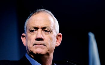 Retired Israeli general Benny Gantz, one of the leaders of the Blue and White political alliance, looks on during a campaign event in the Israeli southern city of Ashkelon on April 3, 2019.