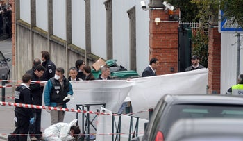FILE PHOTO: Policemen at work near the 'Ozar Hatorah' Jewish school, where Mohamed Merah killed children and a teacher, Toulouse, France, March 19, 2019.