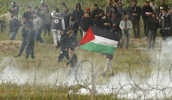 Palestinians demonstrate on the Gaza border, March 30, 2019.