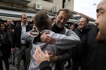 File photo: Moshe Feiglin greets people as he campaigns ahead of election at Mahane Yehuda market in Jerusalem, April 4, 2019.