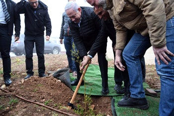 Prime Minister Benjamin Netanyahu planting a tree in a West Bank settlement, January 28, 2019.