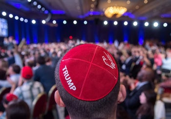A man wears a Trump yarmulke prior to a speech by US President Donald Trump during the Republican Jewish Coalition 2019 Annual Leadership Meeting in Las Vegas, Nevada, April 6, 2019.