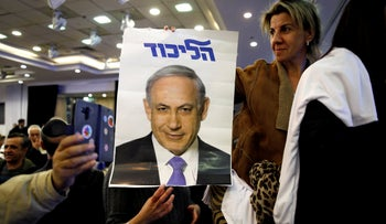 Supporters of the Likud Party hold a photo of Prime Minister Benjamin Netanyahu at the launch of Likud party's election campaign in Ramat Gan, Israel March 4, 2019.