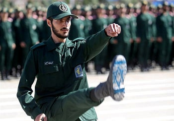 An Iranian Revolutionary Guards officer, with Israel flag drawn on his boots, at a graduation ceremony for military cadets. Tehran, Iran. June 30, 2018
