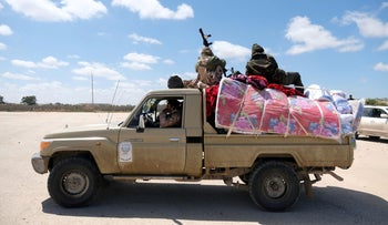 Libyan National Army (LNA) members, commanded by Khalifa Haftar, head out of Benghazi to reinforce the troops advancing to Tripoli, in Benghazi, Libya April 7, 2019.