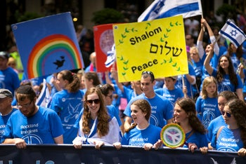 People march along Fifth Ave. during the Celebrate Israel Parade, Sunday, May 31, 2015, in New York